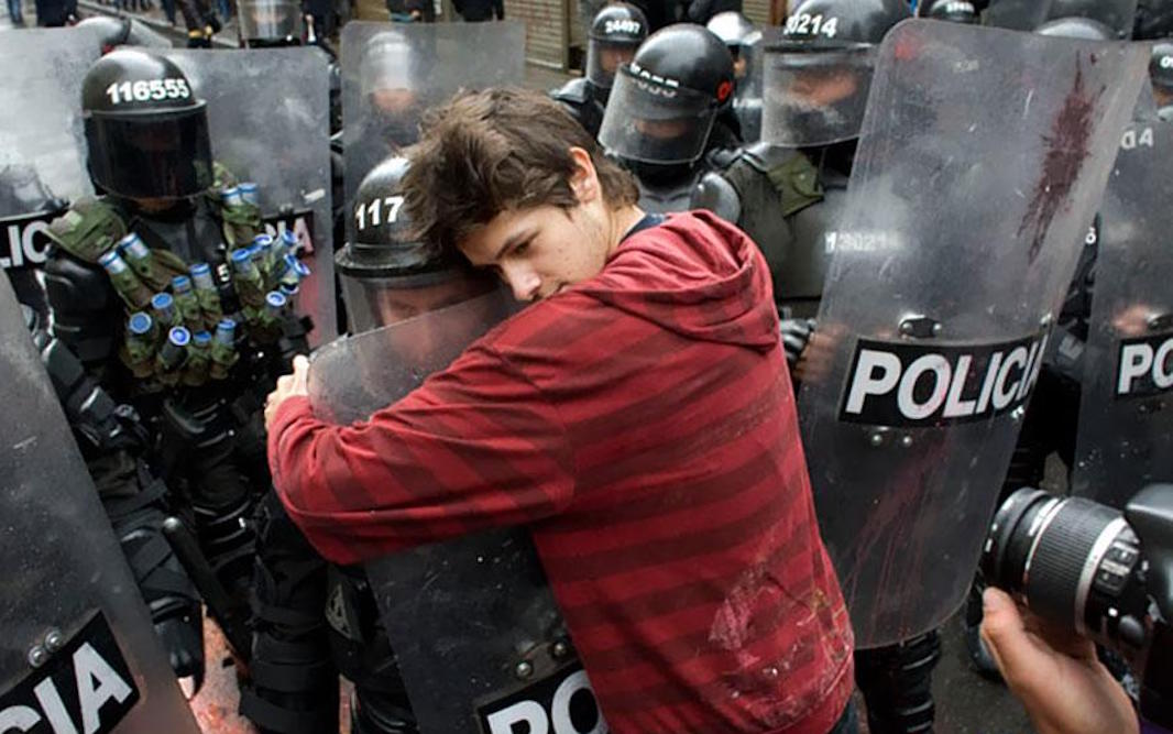 17 Powerful Moments Of Peace During Violent Protests